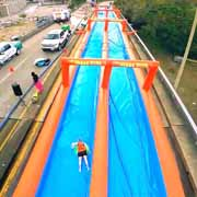 slide the city bringing giant slip and slide